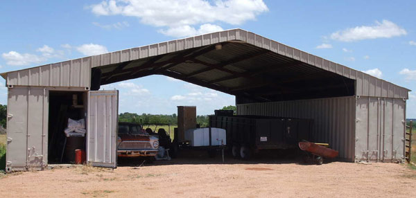 Mobile storage containers modified to create workshop for 40 ft trusses for sale